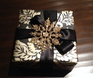 Damask Wallpaper with Black Satin Ribbon and Gold Glitter Snowflake