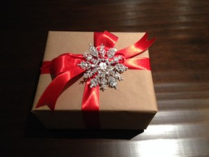 Brown Kraft Paper with Red Satin Ribbon and Silver Glittery Snowflake